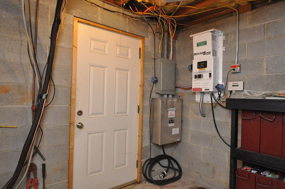 mud room and back basement entry shown in this photo is the back exterior door and the main solar box as well as the back up batteries for the system.