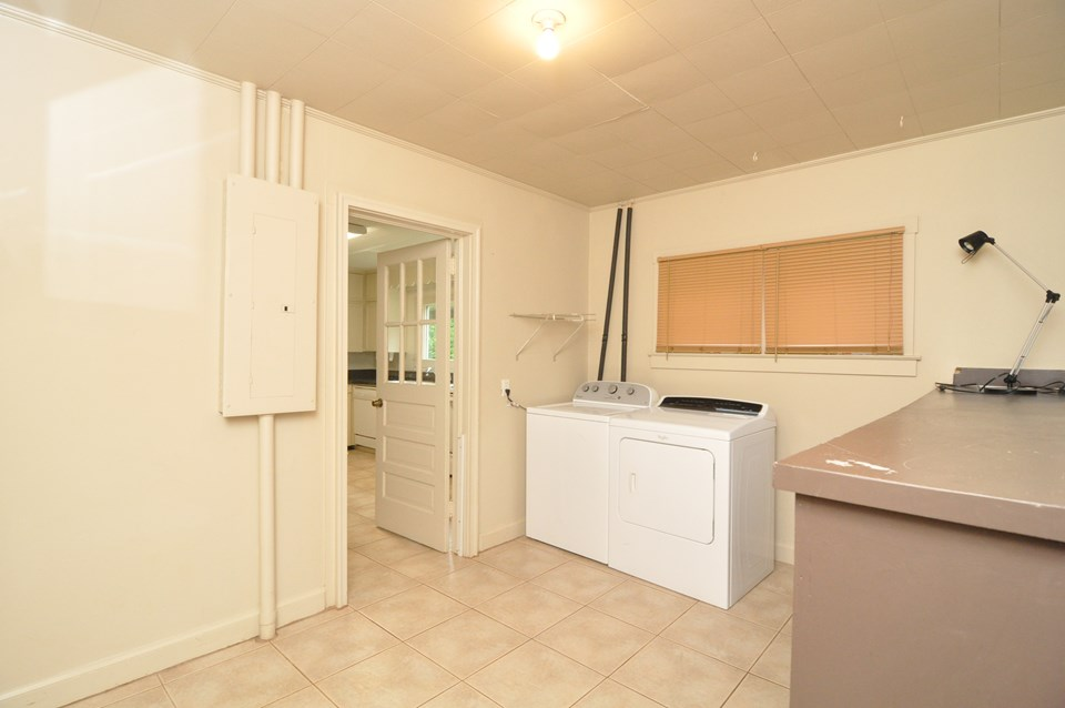 laundry room the spacious 12 x 9 laundry room  has a tile floor, storage cabinet, washer and dryer.  not shown is the side door that opens out of the left side of the house.  the laundry is finished but not vented for heat and air.