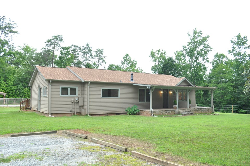 front of the house comfortable ranch style home has fiber cement siding.  the roof is architectural shingle and was installed in 2015 along with a complete new hvac system.  the front porch is 32 x 8.  front door opens to the living and dining room combo. the kitchen is located to its left with the small picture window.  side door on the left goes to the laundry/mud room.