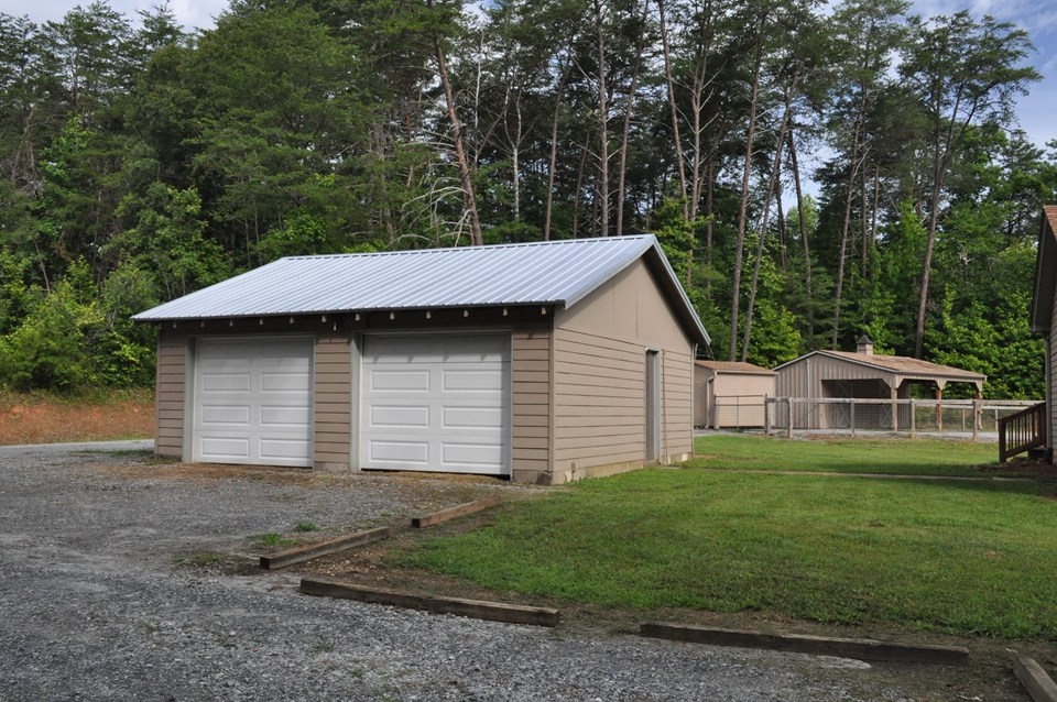 two car garage the garage has fiber cement siding and a metal roof and is 27 x 27.  it has a side entry and power.  the floor is gravel.